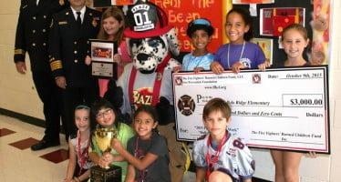École primaire remporte la première place dans FPW bulletin concours du conseil d'administration