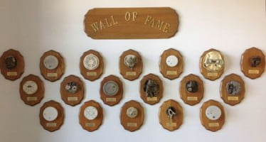 A fire department wall of fame offers a reminder about smoke alarm safety